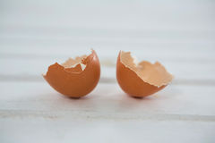 Broken brown Easter egg on wooden surface Royalty Free Stock Photography
