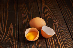 Broken brown egg Stock Images