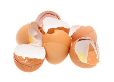 Broken brown eggs on a white background Stock Photography