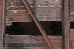 Broken brown wood wall with metal texture. Royalty Free Stock Photography