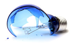 Broken bulb. Broken blue light bulb on a white background stock photos