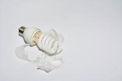 Broken Bulb. The broken household bulb in the table Stock Photo