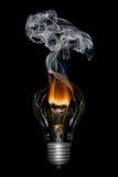 Broken Bulb with Smoke - Bournout. Broken light  bulb with flame and smoke Stock Photography