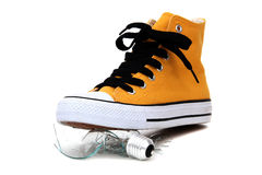 Broken bulb under sneaker Royalty Free Stock Photos
