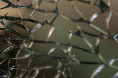Broken bulletproof glass close up Stock Image