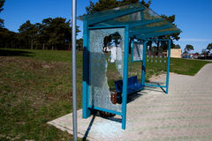 Broken bus stop. Damaged glass at a bus stop shed Royalty Free Stock Photography