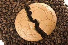 Broken cake. The broken macaroon on the coffee grain Stock Photography