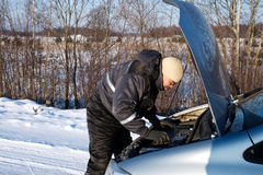 Broken car. Man checked the broken car engine in cold winter day Stock Images