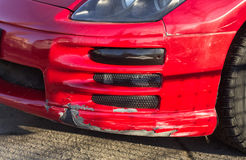 Broken car bumper of  red sport car with lowered suspension Royalty Free Stock Photos