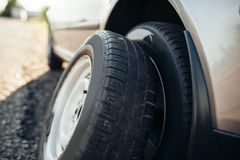 Broken car concept, spare wheel replacement Stock Images