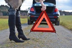 Broken car, girl and triangle Stock Photos