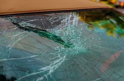 Broken car glass cracked for accident repair front window. Broken front window car glass cracked for accident repair windshield crash shattered wreck destruction royalty free stock images