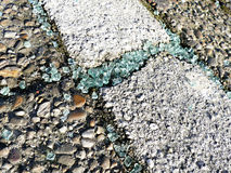 Broken car glass shards on pavement.  stock photos