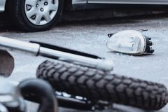 Broken car light after collision. Broken car light lying on the street after a collision with drunk motorcyclist royalty free stock images