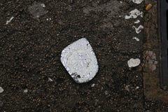 Broken car mirror over wet asphalt Royalty Free Stock Image