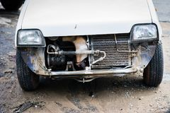 Broken car parking in garage Stock Image