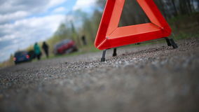 Broken car on the roadside. red warning triangle stock footage