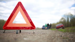 Broken car on the roadside. red warning triangle stock video