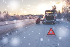 Broken car on a snowy winter road stock photography