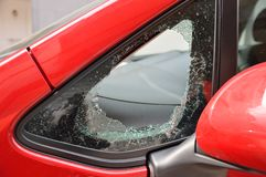 Broken car by theft. Broken door window of a car after a theft royalty free stock photography