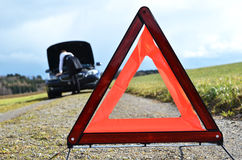 Broken car and triangle Stock Photography