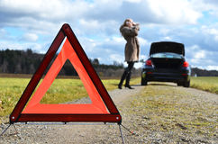 Broken car and triangle Stock Photos