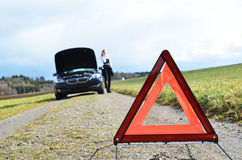 Broken car and triangle Royalty Free Stock Photo