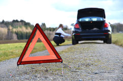 Broken car and triangle Royalty Free Stock Image