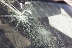 Broken car window, an accident on the road. Safe movement. Broken car window, an accident on the road. Safe movement stock photos