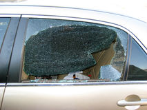 Broken Car Window. Broken back window on a car that was broken into by thieves royalty free stock photography