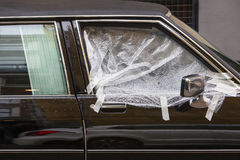 Broken car window covered with plastic Stock Photo