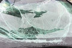 Broken car windshield. Broken glass on a gray car in a repair shop stock photos