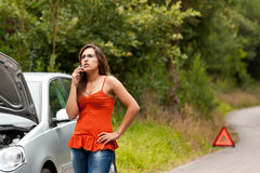 Broken Car - Young Woman Calls for Assistance stock photo