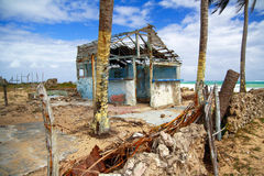 Broken caribbean house on beach Royalty Free Stock Images