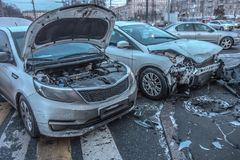 Broken cars after accident. Cityscapes. Cityscapes. Damaged bumpers from car accident. Two cars in collision on roadway stock photos