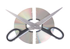 Broken CD disc with scissors isolated on white bac. Kground Royalty Free Stock Photo