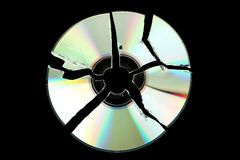 Broken cd. Isolated on black background Stock Image
