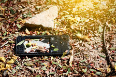 Broken cell on the ground. Royalty Free Stock Photography