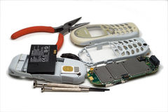 Broken cell phone. With tools stock photography