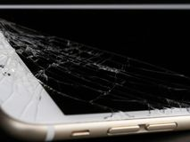 Broken Cell Phone on Black Background stock image
