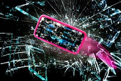 Broken Cell Phone. Broken cell phone going through shards of glass stock photography
