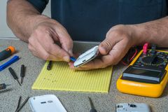 Broken cell phone repair. Smartphone parts and tools for recovery, selective focus stock photo