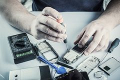 Broken cell phone repair stock photo