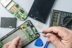 Broken cell phone repair royalty free stock photo
