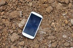 Broken Cell phone On Soil Surface. Stock Image