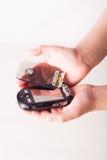 Broken cellphone in man's hands. Black Smartphone with Broken flip in man's hands Royalty Free Stock Photography