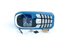 Broken cellular phone and two microchips Stock Images