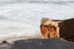 Broken Cement wall sea wave iron Rust royalty free stock photo