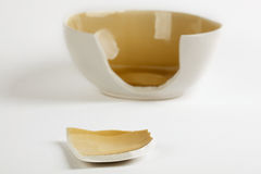 Broken ceramic cup. On neutral background Royalty Free Stock Image
