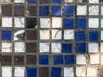 Broken ceramic mosaic on a concrete basis. stock images